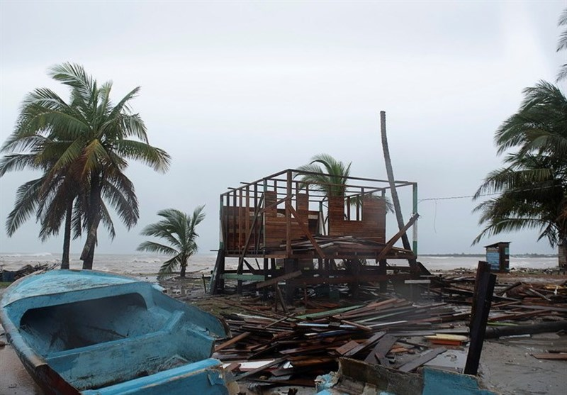 Structure and boat in pieces after hurricane Iota